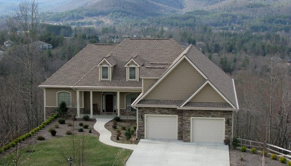 A home in Cummings Cove with double garage doors and long distance winter views.