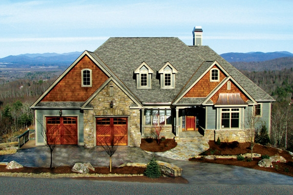 A home in Cummings Cove with wood garage doors and copper accents.